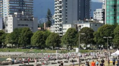 People enjoying First Beach on English Bay