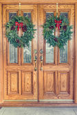 Christmas Wreaths on Front Doors — Stock Photo