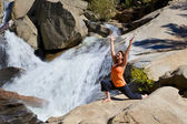 Practicing Yoga at Waterfall — Stock Photo