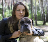 The slender girl with a dog — Stock Photo