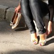Feet of the girl who is changing clothes of shoes with low on a high heel — Stock Video