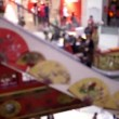 Stock video: Silhouettes of people on escalator in shopping center