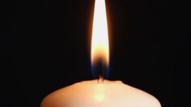 Burning candle suddenly goes out close-up — Stock Video