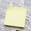 Newspaper and sticky note — Stock Photo #10775015