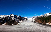 Salmon Glacier and star trail — Stock Photo