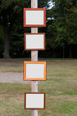 Picture Frame on wooden pole — Stock Photo