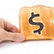 Bread slice with dollar sign — Stock Photo #22198951
