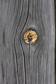 Weathered wood with knot — Stock Photo