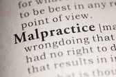 Fake Dictionary, Dictionary definition of the word Malpractice. — Stock Photo