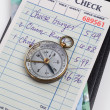 Guest Check and compass — Stock Photo