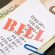 Bills and canadian dollars — Stock Photo