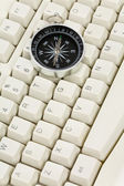 Computer Keyboard and Compass — Stock Photo