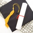 Stock Photo: Black Mortarboard and computer keyboard