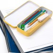 Stock Photo: Metal pencil case and book