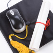 Black Mortarboard and computer mouse — Stock Photo #34992515
