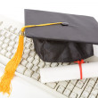 Black Mortarboard and computer keyboard — Stock Photo