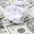 Stock Photo: Calendar paper ball and dollar