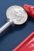Vise Grip and coin — Stock Photo