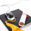 Black Mortarboard and computer mouse — Stock Photo #35688147