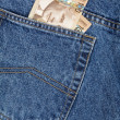 Blue jean and canadian dollars — Stock Photo