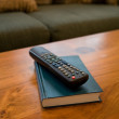Remote Control and coffee table — Stock Photo