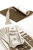 Black Mortarboard and dollar — Stock Photo