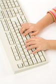 Child hand and Keyboard — Stockfoto