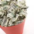 Dollars in Red Garbage Can — Stock Photo #43535001