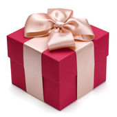 Red gift box with golden ribbon. — Stock Photo