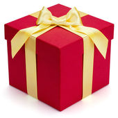 Red gift box with yellow ribbon and bow. — Stock Photo