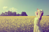 Beautiful young girl in the summer field. — Stock Photo