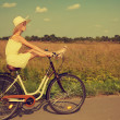 Young girl having fun riding a bike. — Stock Photo #51403869
