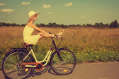 Young girl having fun riding a bike. — Foto de Stock