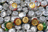 Background of crashed beer cans — Stock Photo