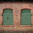 Window in the brick wall and old steel shutters closed — Stock Photo
