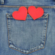 Back pocket of jeans with hearts — Stock Photo