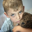 Small sad boy with eye bruise and teddy bear — Stock Photo #29897835