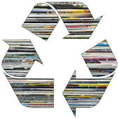 Recycle symbol with old magazines — Stock Photo