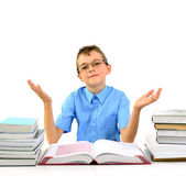 Young boy with open hands and books — Stock Photo