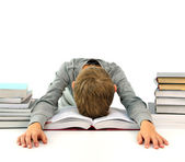 Tired and bored boy with books — Stock Photo