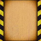 Warning stripes frame with rusty plate — Stock Photo
