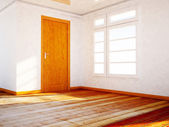 Empty room with a wooden dorr and a window — Stock Photo