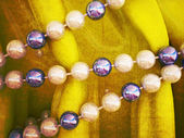Beads on a yellow cloth, — Stock Photo