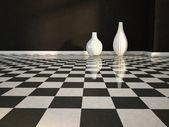 Two white vases on the floor — Stock Photo