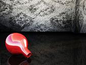 En vas på golvet mörkt — Stockfoto