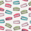 Seamless pattern with hand drawn macaroons. Vector background — ストックベクタ