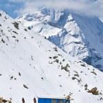 Snowplow in alpine road — Stock Photo #6343146