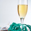 Champagne glass, ribbons and confetti — Stock Photo #6348088