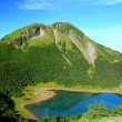Mountain and blue pond - Stock Photo