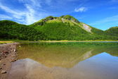 Mountain and pond — Stock Photo